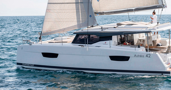 Catamaran Astréa 42 outside view with a person navigating the boat